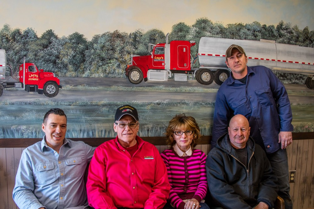 The staff of Ferrell Oil Company posing inside of the lobby