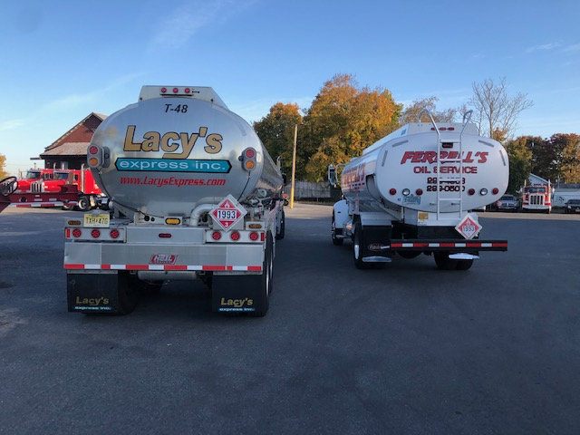 Tails of two trucks showing the Lacy's and Ferrell logos